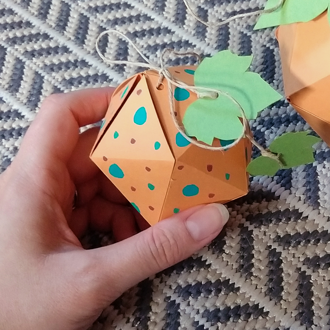 Hand-painted paper pumpkin craft project