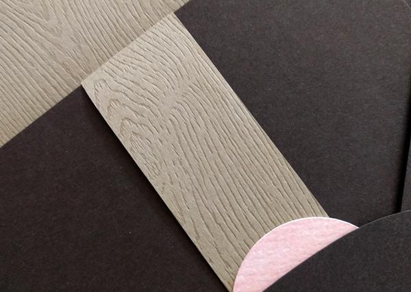 Closeup of woodgrain texture on invitation