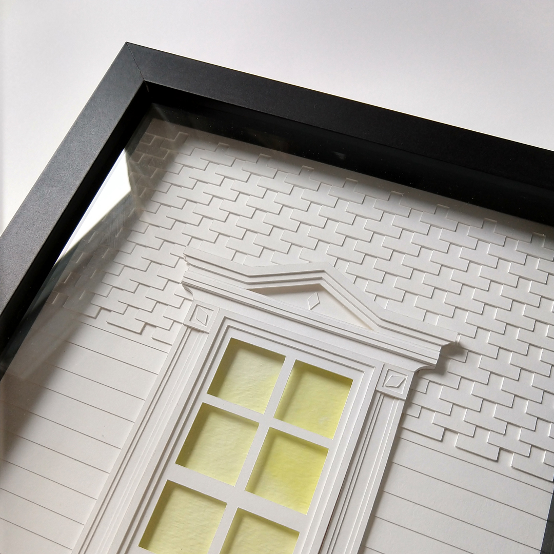 Angled view of a framed paper window with intricate siding and trim details, window panes are cut-out to reveal a watercolor painted background