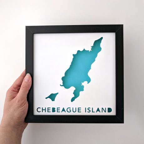 Framed map of Chebeague Island, Maine, held in hand