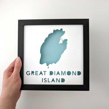 Framed map of Great Diamond Island, Maine with a light blue background held in hand