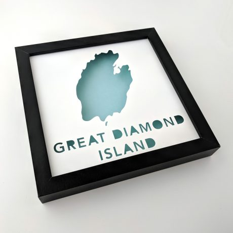 Framed map of Great Diamond Island, Maine at an angle with a light blue background