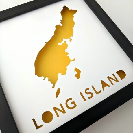 Framed map of Long Island, Maine with yellow background at an angle