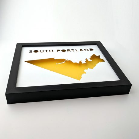 Angled view of South Portland map with yellow background in black frame