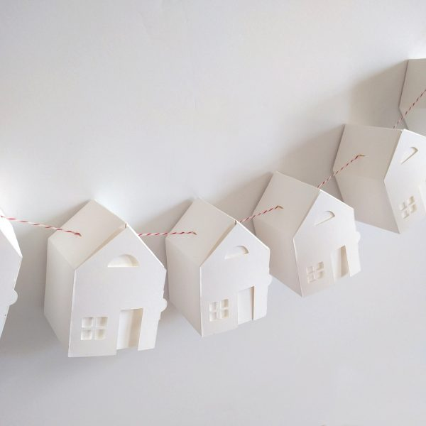 Assembled tiny house garland kit assembled and in front of a white wall