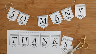 "Partially-assembled printed ""So Many Thanks"" banner"