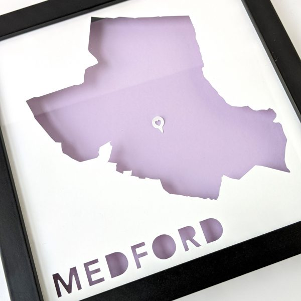 Framed map of Medford, MA with a heart-shaped place marker indicating the location of the customer's home.