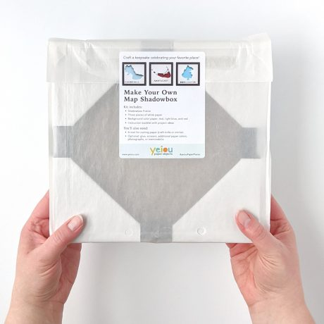 Packaged DIY Paper Place kit held in two hands