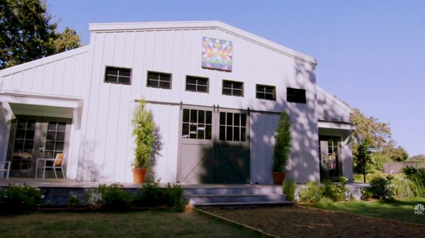 """Still from the """"Making It"""" intro sequence showing the exterior of the barn on a sunny day"""
