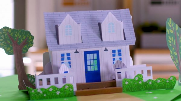 Still frame from the show's title sequence depicting a paper pop-up version of the cottage