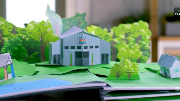 """Still from the """"Making It"""" title sequence showing a pop-up book version of the barn surrounded by trees"""